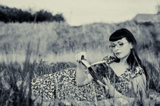 Leopard in the meadow by CarrieGrr