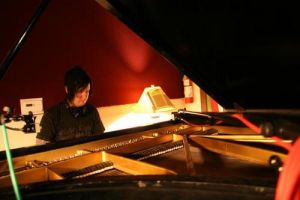 The Rev Playing the Paino by GrimAsEver
