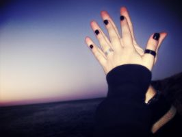 Our hands at sunset by VicK88