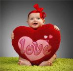 Baby holding a love heart plush for Valentines Day by ArianaMontana