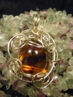 simple free form amber and silver pendant by BacktoEarthCreations