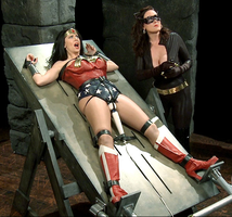 Wonder Woman Captured and Strapped to Table by coolguy453