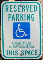 Handicap Parking Lot Sign by FantasyStock