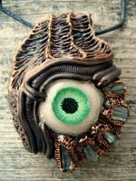 Biomech tourmaline eyeball pendant by dogzillalives