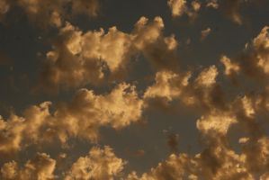 sunset in clouds 2 by Her-Redness