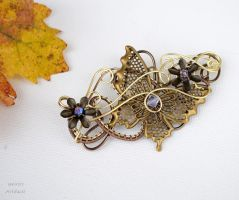 Vintage butterfly wire wrapped brooch by IanirasArtifacts