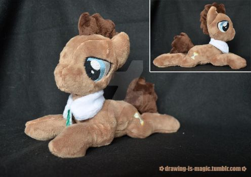 Doctor Whooves plush laying by Mana-Kyusai