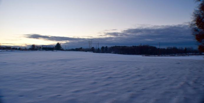 The snowy field and the incoming storm by Bushi357