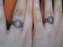 Steampunk Wedding Ring Tattoos by veririaa