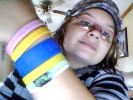 My bracelets and my awesome hat by CaitlynNicoleWright