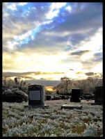Sunset Cemetary by ThaIllusionist