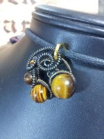 Tigers eye in Gunmetal Coils by BacktoEarthCreations