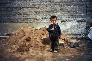 Boy and his dirt pile by avotius