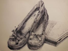 A pair of shoes over Books by DewLaddenTree