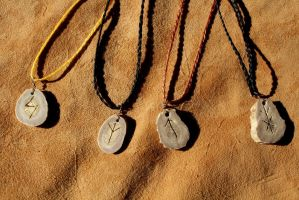 Carved deer antler rune necklaces by lupagreenwolf