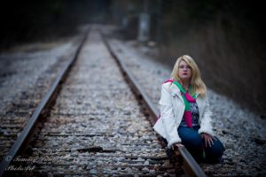 sitting on rail by Tommy8250
