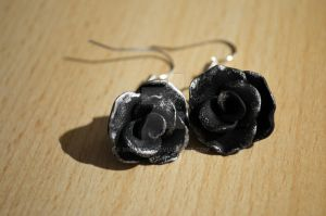 rose earrings by xmasdog