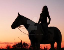 Riding at sunset by katie4469