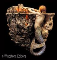 Mermaid candle sconce by Reptangle