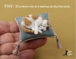 Sleeping Cat Sculpture by Pajutee