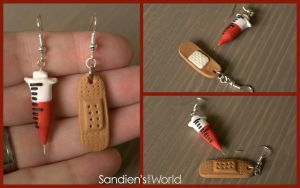 Syringe and bandage earrings by Sandien
