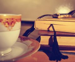 books and cup by MaithaNeyadi