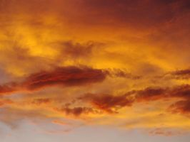 summer clouds colored by the setting sun by imthinkingoutloud