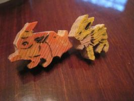 flareon and jolteon earrings by MagicalMegumi
