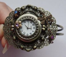 Purple dragonfly watch-cuff by Pinkabsinthe