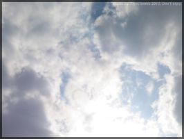 Clouds... by TigaLioness