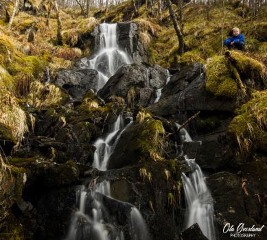 Boy in waterfall by olaover