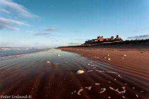 Last light at Bamburgh Castle by Pistolpete2007