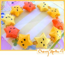 Orange origami star bracelet by CherryAbuku