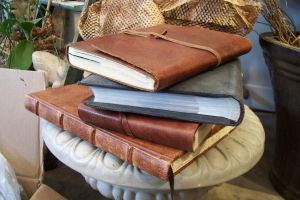 Stock Leather Books stacked by paintresseye