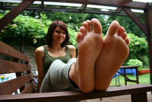 Franzi exposing her soles of feet by foot-portrait