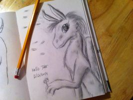 A look inside of my sketchbook: A gentle dragon by DragonDrawer102