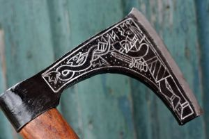 Axe engraving-other side 1 by Dewfooter