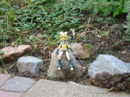 Rin: Sitting on a rock by Avril170