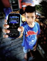 A Boy with his new Cellular by djati