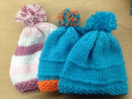 Knitting baby hats!!! by StarBird18