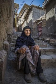 Old woman on the road by Aws-alnaimi