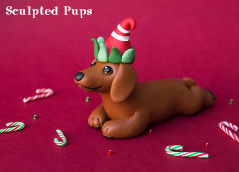 Dachshund with an elf hat by SculptedPups