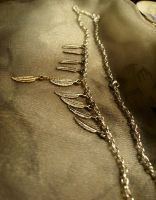 9 feathers of Altair-necklace by Destinyfall