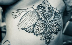 skull tattoo wings 4 by RemiisMeltingDots
