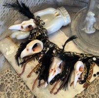 Goth bird skull jewelry by troseleigh