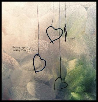 Hanging hearts by dusty-soul