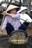 Woman on a boat, Vietnam by gatonegro2551