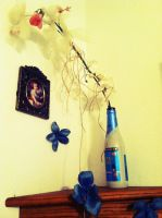 Faux flowers with beer bottle and corner shelf by heatherdrefke