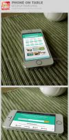Phone on Table Mockup Templates by loswl