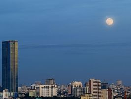 Supermoon over the city by BlueTF